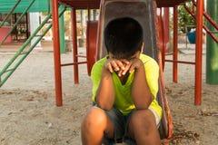 Boy sad alone  at playground Stock Photography