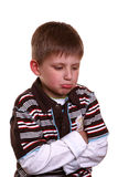Boy with sad face. Little blond boy with sad face stock images