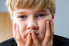 Boy is sad. Boy looking sad and lonely Royalty Free Stock Photo