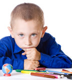 The boy is sad thinking about school Stock Image