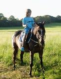 Boy in a Saddle of Horse Horseback Riding Royalty Free Stock Image