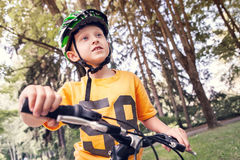 Boy in safe helmet ride a bicycle Royalty Free Stock Images