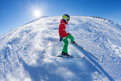 Boy in safety helmet and mask on the ski route Stock Photo