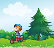 A boy with a safety helmet riding in his bike stock illustration