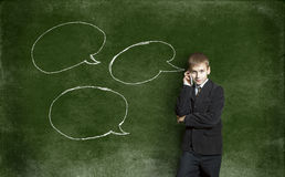 The boy said by telephone amid the drawing with chalk on the Bla Royalty Free Stock Photo
