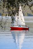 Boy and sail boat stock photography