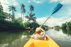 Boy sailing in canoe boat on tropical lagoon Royalty Free Stock Photography