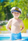 Boy with sailor cap in swiming pool. In summer Royalty Free Stock Image