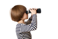 A boy in sailor's striped vest with binoculars Royalty Free Stock Photo