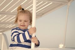 Boy sailor travelling sea. Child cute sailor enjoy journey on cruise liner. Kid adorable striped shirt yacht travel. Around world. Baby boy excited about stock image