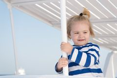 Boy sailor travelling sea. Child cute sailor enjoy journey on cruise liner. Kid adorable striped shirt yacht travel. Around world. Baby boy excited about stock images