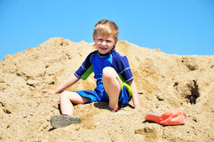 Boy in sand Royalty Free Stock Image