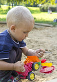 Boy on sand. Small boy playing in the sand Royalty Free Stock Photo