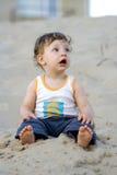 Boy on the sand. Boy sit on the sand Stock Photo
