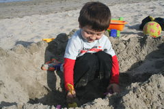 Boy in sand Royalty Free Stock Photo