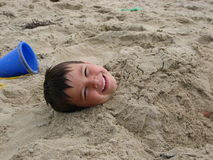 Boy in sand stock photo