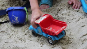 Boy in sand and machine Stock Photo