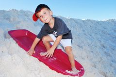 Boy sand sledding Stock Images