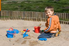 Boy In Sandbox Stock Photo