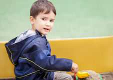 Boy in sandbox Stock Image