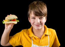 Boy with sandwich in hand Royalty Free Stock Image