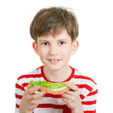 A boy with a sandwich Royalty Free Stock Photography