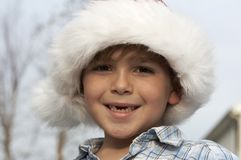 Boy santa Stock Images