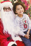 Boy with Santa Stock Image