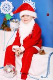 Boy Santa Claus. Santa boy on a blue  background Royalty Free Stock Photo