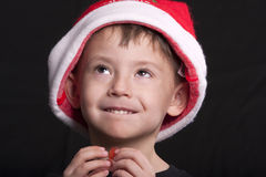 Boy in Santa Claus hat Stock Images