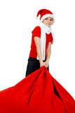 Boy in Santa Claus hat with Christmas Gift Bag Royalty Free Stock Image