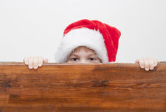 Boy with Santa Claus Hat Royalty Free Stock Photos