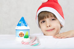 Boy in Santa Claus hat stock photography