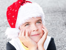 Boy in a Santa Claus hat. Smiling child wearing Santa Claus hat Royalty Free Stock Photos