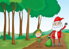 A boy and a santa claus Royalty Free Stock Images