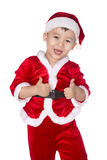 Boy in Santa Claus stock images
