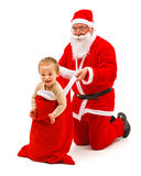 Boy in Santa Claus's bag Royalty Free Stock Photo