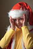 Boy in Santa Claus suit open face. Stock Photo