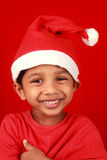 Boy in Santa dress Stock Photo
