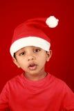 Boy in Santa dress Stock Photography