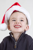 Boy in Santa hat Stock Images