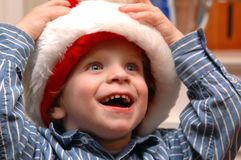 Boy in Santa hat. A happy young boy in a santa hat Stock Photo