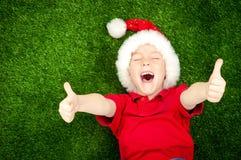 Boy in santa hat Stock Image