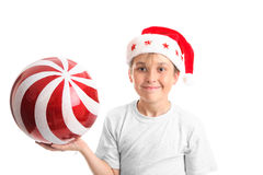 Boy in Santa hat with ball Royalty Free Stock Images