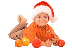 Boy in santa hat and baubles Stock Photos