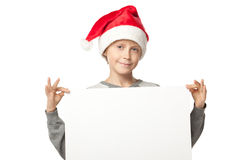 Boy in Santa hat with blank board Royalty Free Stock Photo