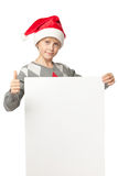 Boy in Santa hat with blank board Royalty Free Stock Photography