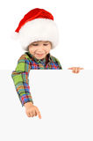 Boy in Santa hat with blank board. Happy little boy in Santa hat with blank board on white background Stock Photo