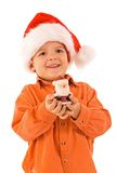 Boy with santa hat and candle Royalty Free Stock Photography