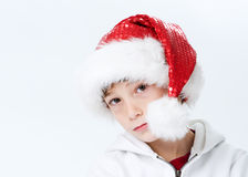 Boy in a santa hat Royalty Free Stock Images